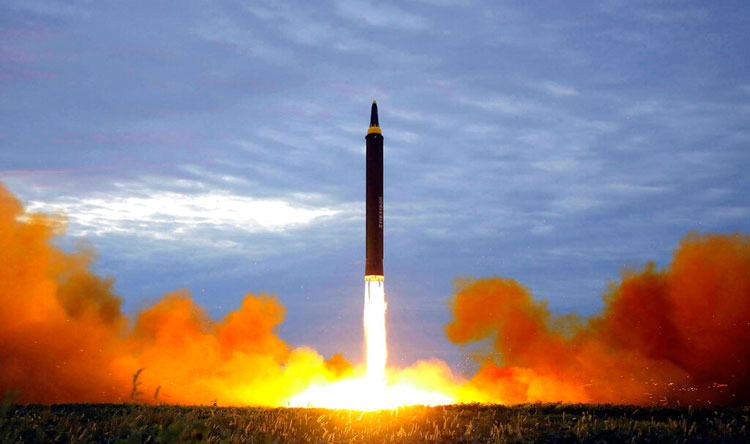 A file photo by the North Korean government shows the test launch of a Hwasong-12 intermediate range missile in Pyongyang, North Korea.