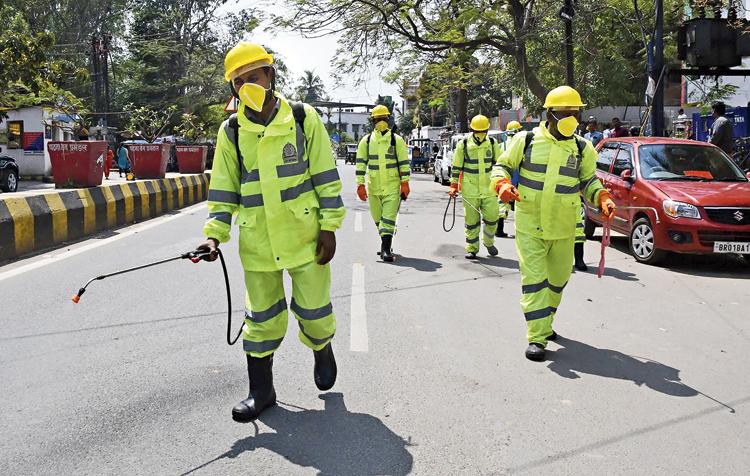 Patna civic body volunteers spray disinfectant as a precautionary measure against coronavirus in Patna.