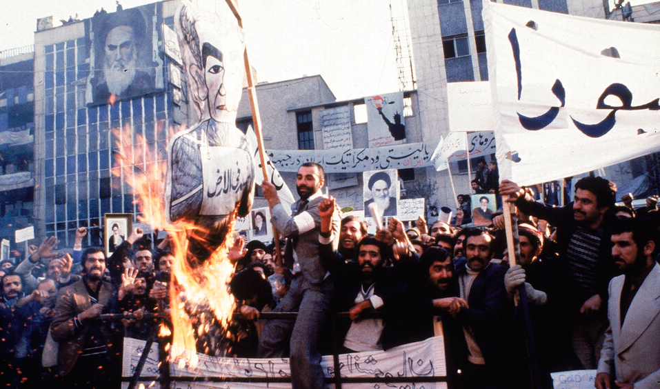 In an undated photo from 1979, protestors burn an effigy of Shah Mohammad Reza Pahlavi during a demonstration in front of the US Embassy in Tehran, Iran.