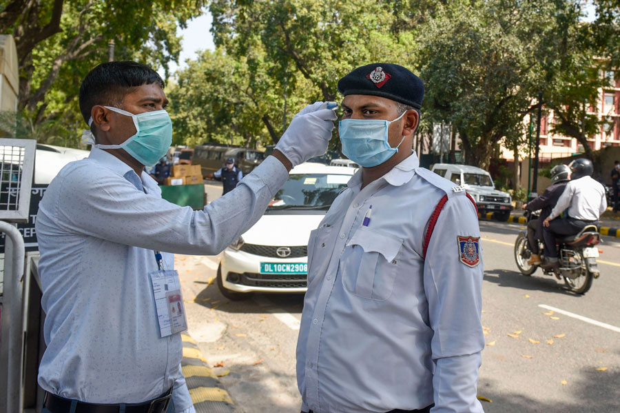 Thermal screening is conducted in the wake of deadly coronavirus pandemic, at the entrance gate of Parliament, in New Delhi on Monday.