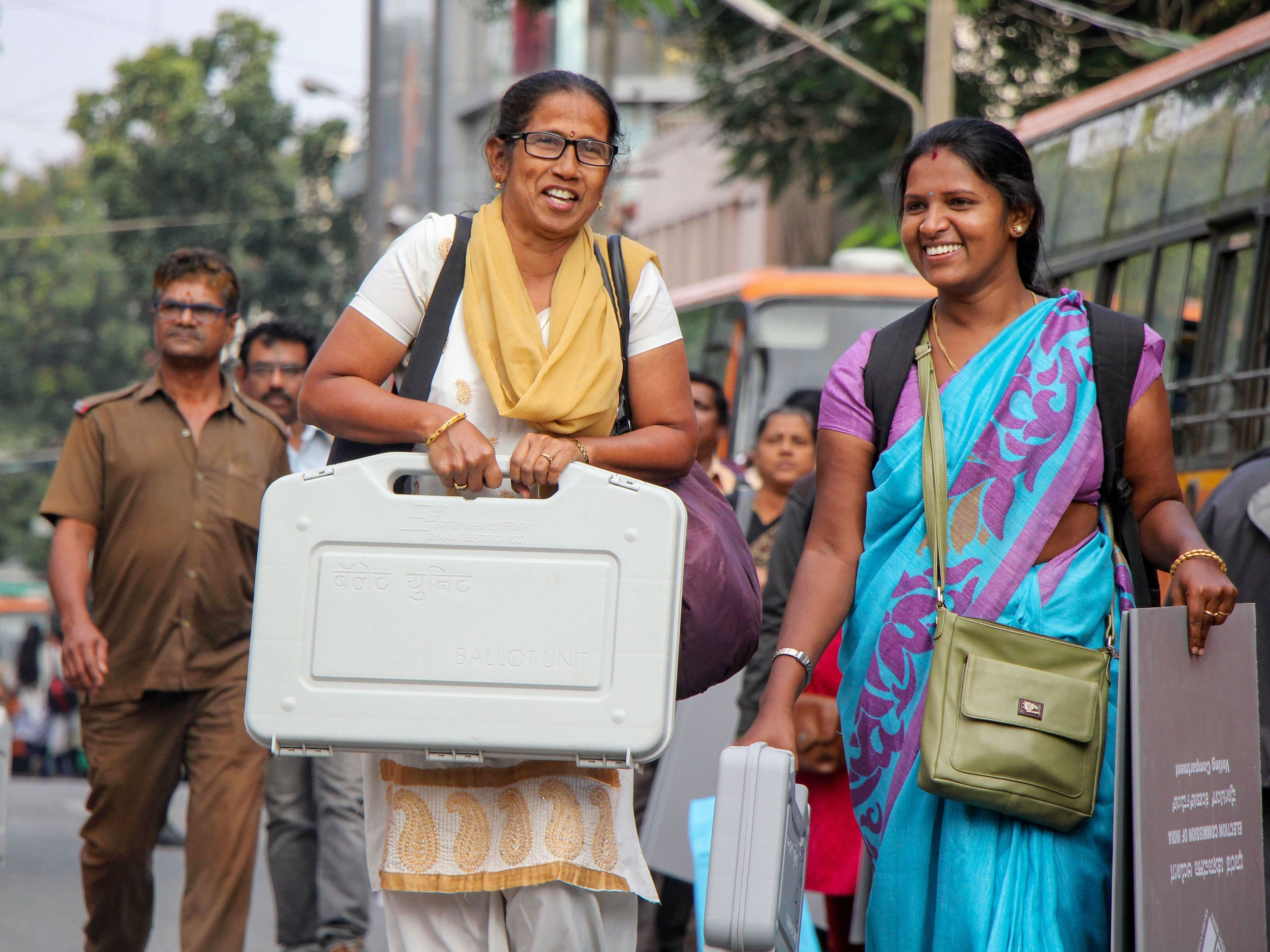 In this file photo taken on the eve of bypolls in Karnataka on Wednesday, Decemeber 4, 2019, polling officials can be seen collecting EVMs and others polling materials.