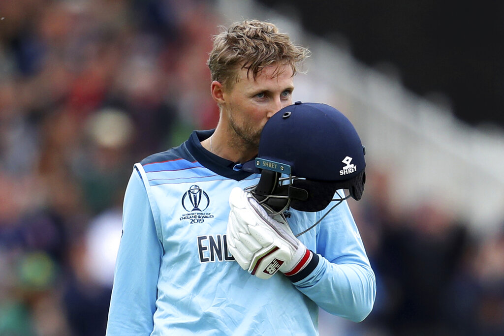 England's Joe Root kisses his helmet after scoring a century during the Cricket World Cup match between England and Pakistan at Trent Bridge in Nottingham, Monday, June 3, 2019