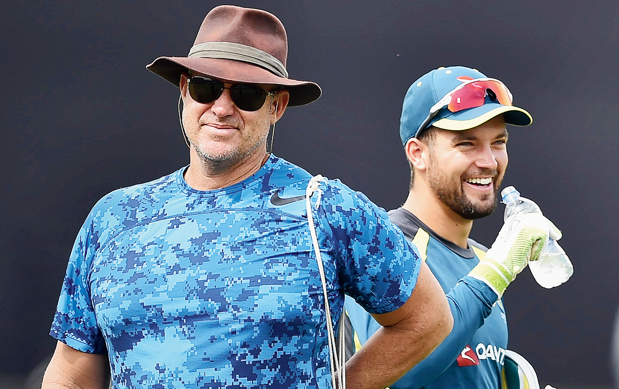 Matthew Hayden with Alex Carey during a practice session at the Kotla on Tuesday.