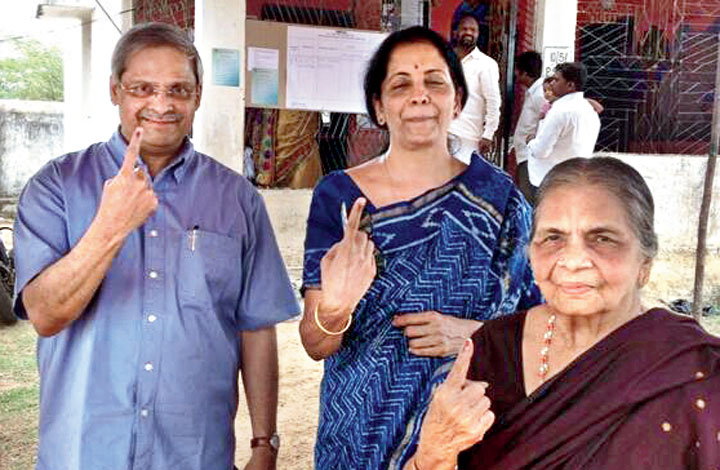 "Nirmala and Parakala Prabhakar in a picture he tweeted on April 29, 2014, with the caption: ""We all voted. Amma, Nirmala & I."""