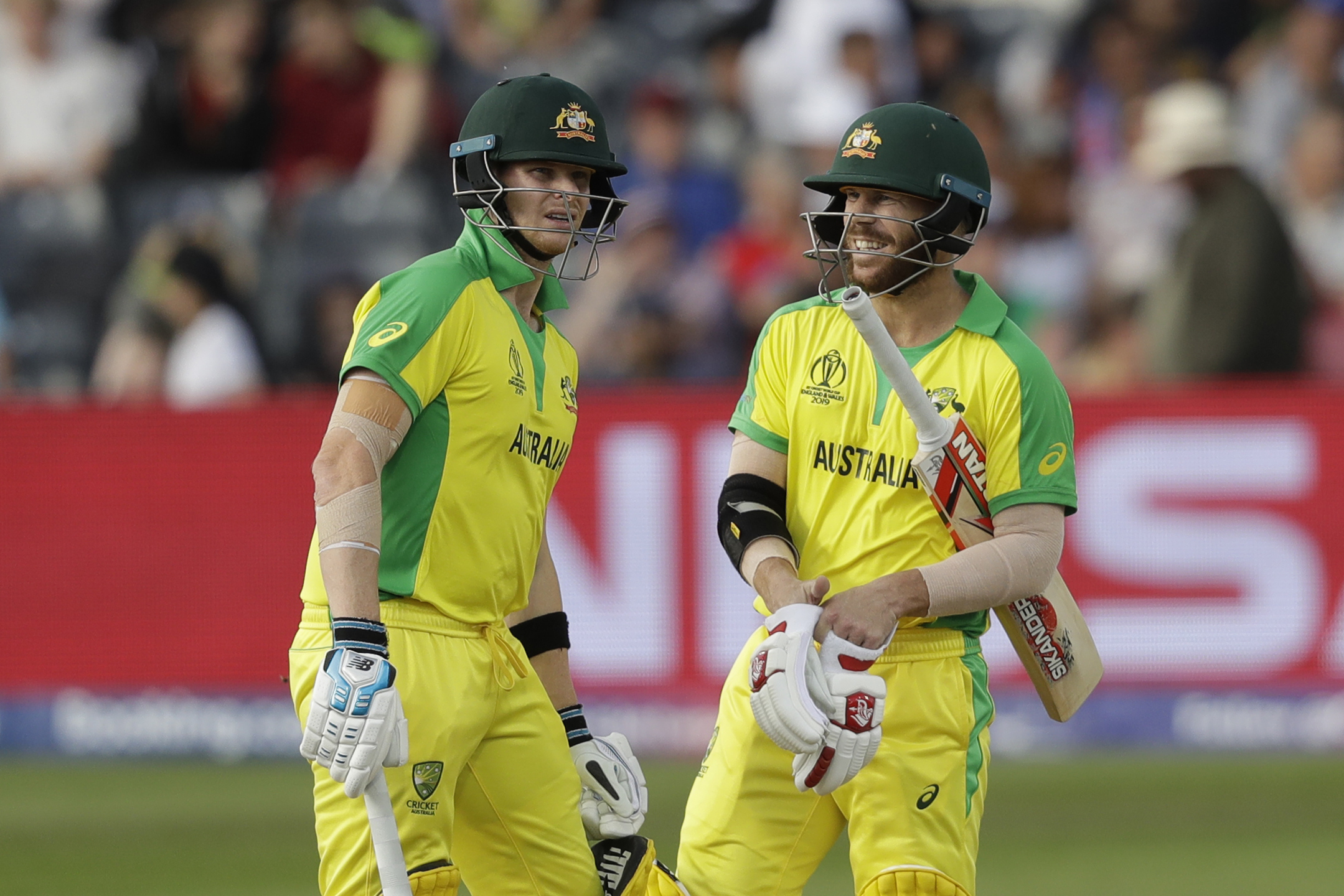 Australia's Steve Smith (left) and David Warner chat after their first batting over against Afghanistan at the Bristol County Ground  on June 1.