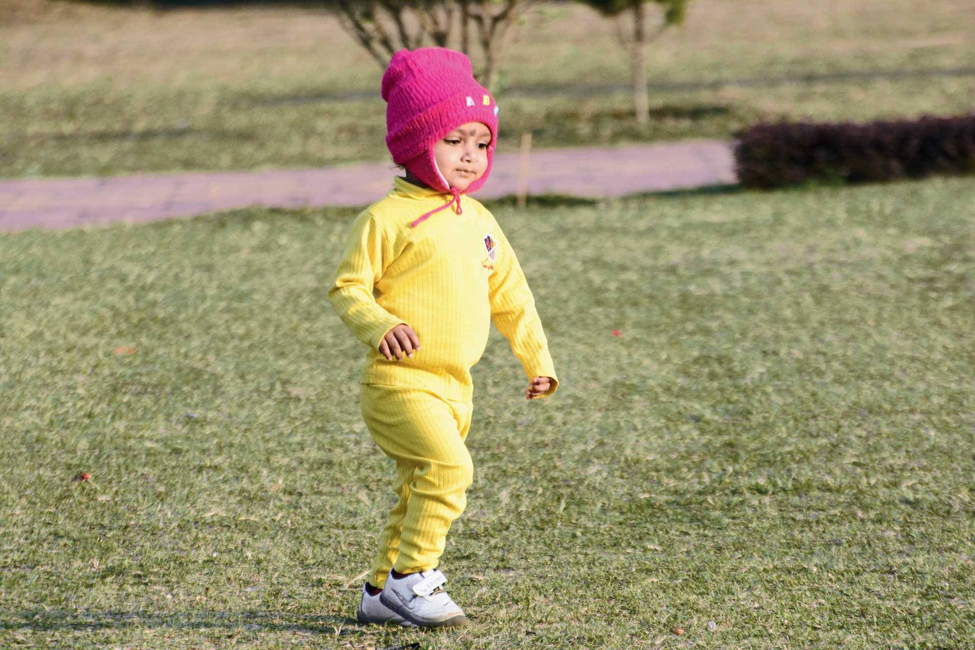 A child in winter gear plays at Jubilee Park on Thursday.