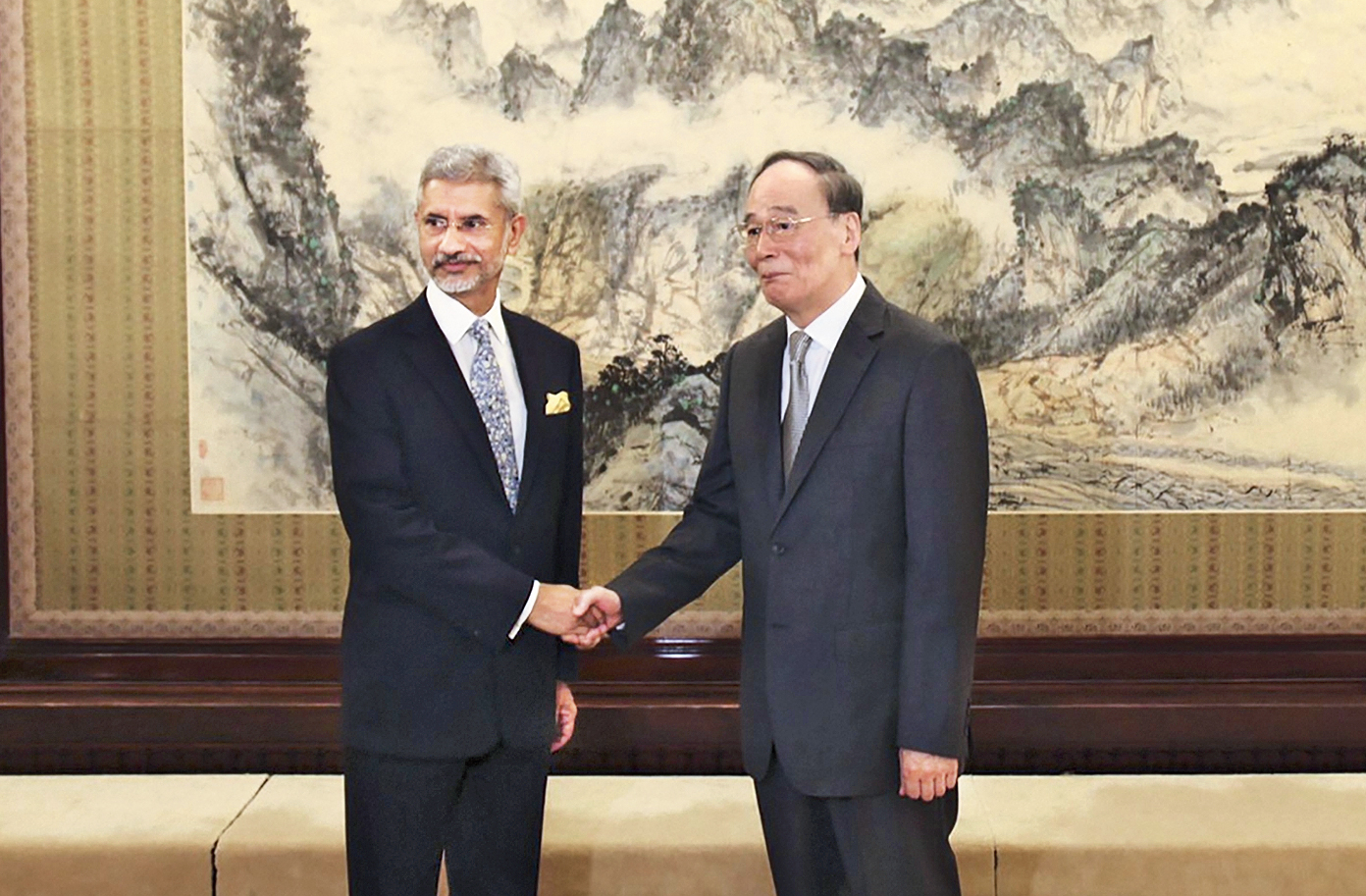 Jaishankar shakes hands with China's Vice-President Wang Qishan in Beijing on Monday.