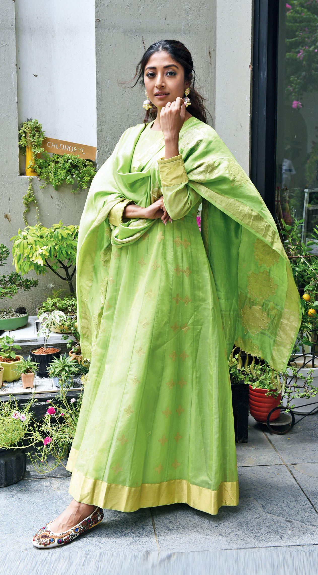 """Fresh and vibrant is this light green Chanderi silk Anarkali with leaf motifs, teamed with a rose handwoven dupatta. """"This is a nice destination wedding day-function look,"""" said Pinki. """"I loved the green. It's a trending colour. I like the cut and the fit and again the fabric is light on the skin. This was also very comfortable. It's great for cocktails, Mehndi too,"""" said Paoli as her eyes were winged out, her cheeks touched with """"sun-kissed blush"""", her lips rubbed with nude brown and her hair tied in a textured pony. """"All the three colours I wore today are actually summer colours. That's what the collection is also all about… very romantic collection. All the colours were versatile,"""" added Paoli."""