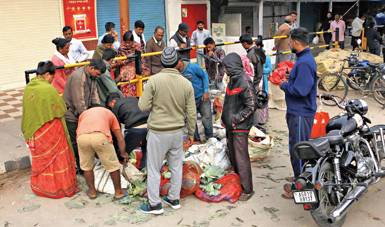 People gather to buy vegetables