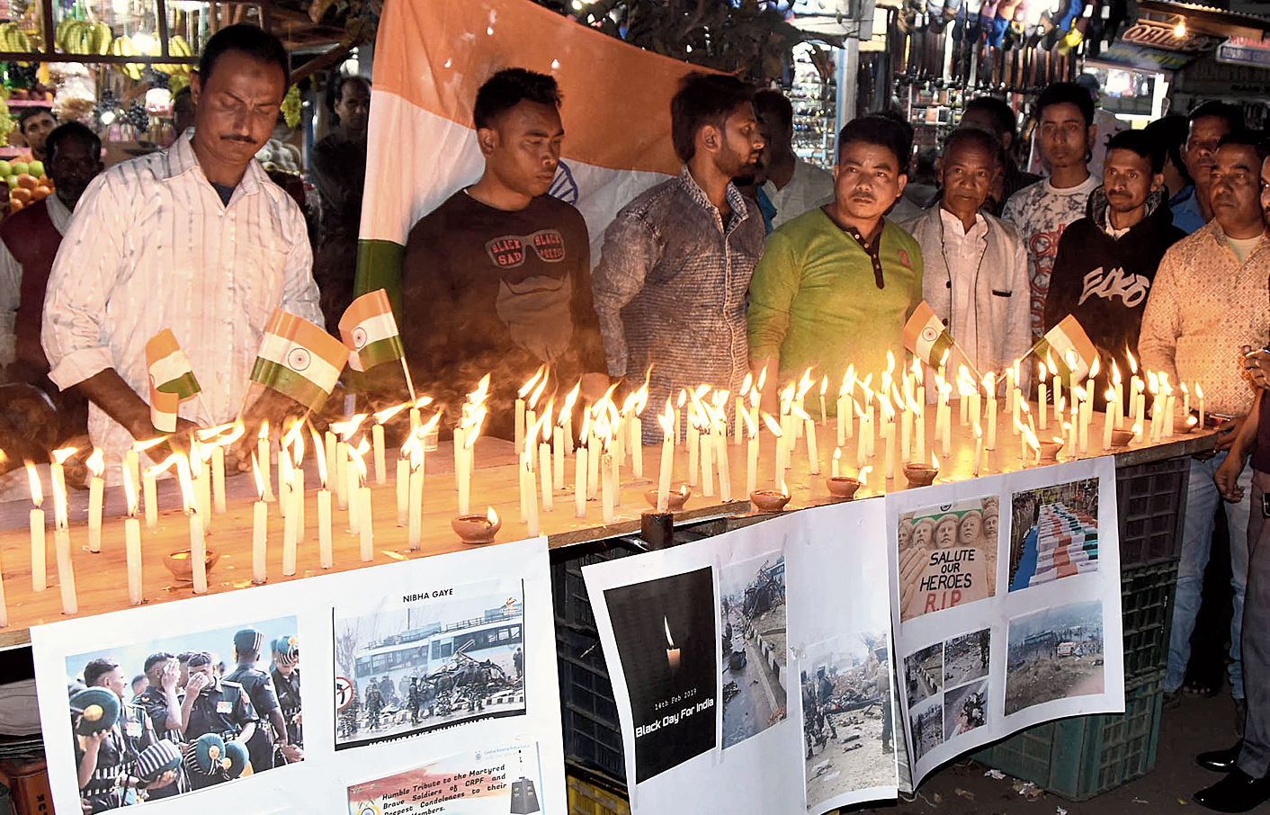 People pay tribute in Tezpur on Friday.