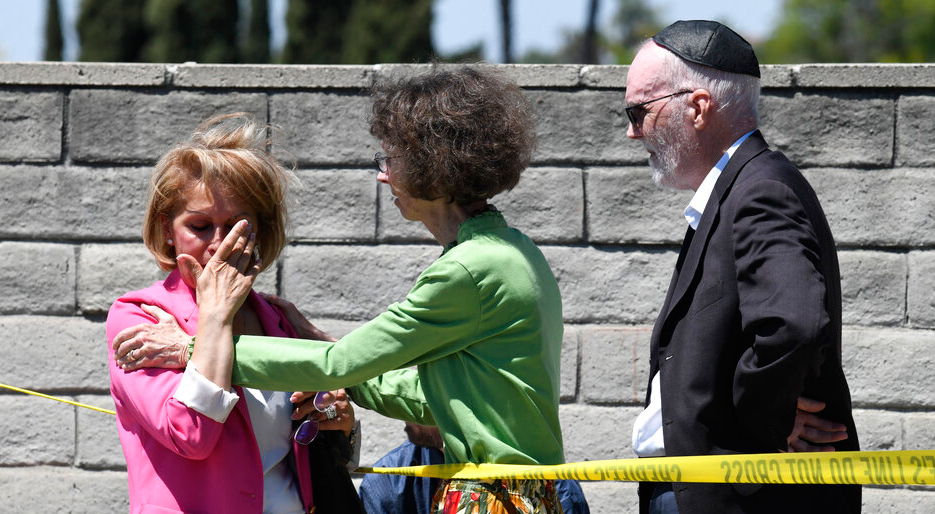 Synagogue members console one another outside of the Chabad of Poway Synagogue Saturday, April 27, 2019, in Poway, California.