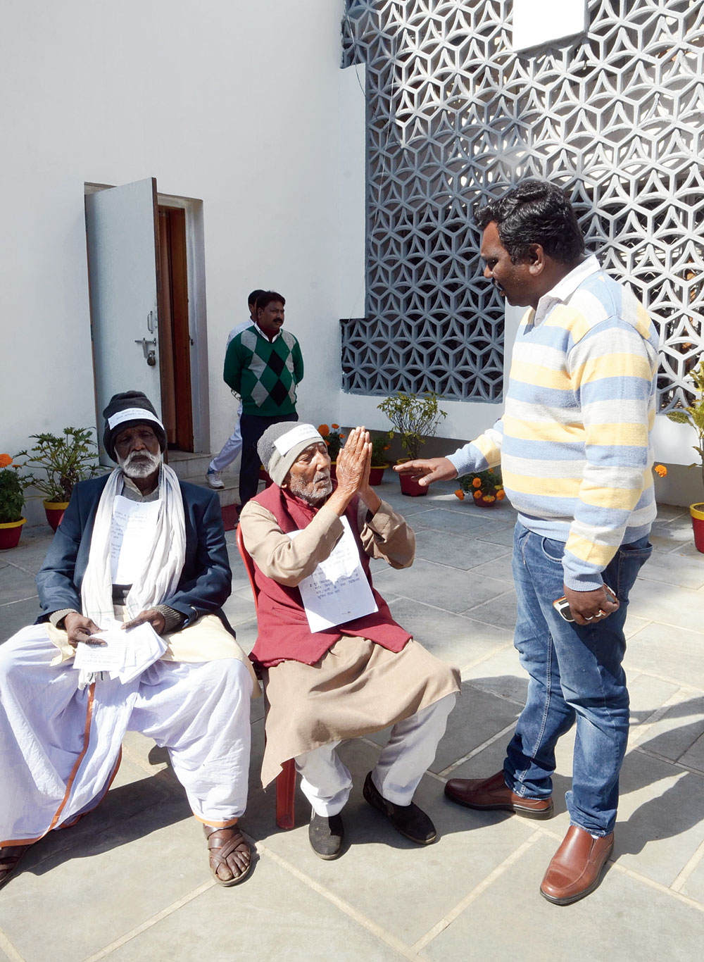 Former MLAs Hemendra Pratap Dehati (in maroon bundi) and Benjamin Murmu request land revenue and sports minister Amar Kumar Bauri to distribute plots among ex-MLAs for construction of houses within a week and ensure proper medical treatment for them