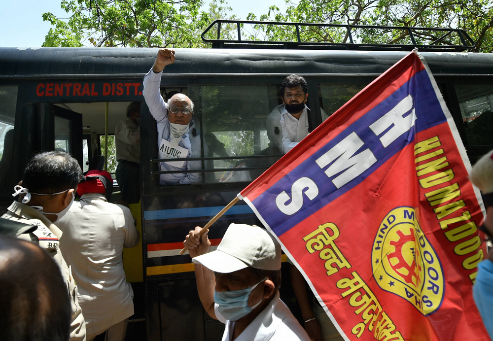 Police detain CITU leaders and activists who were staging a protest against the recent changes in labour laws, at Rajghat in New Delhi, Friday, May 22, 2020.