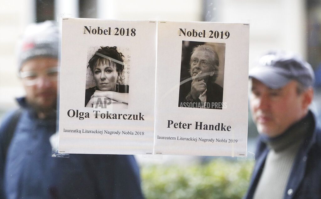 Pictures of Polish author Olga Tokarczuk and Austrian writer Peter Handke outside a bookstore in Warsaw on Thursday.