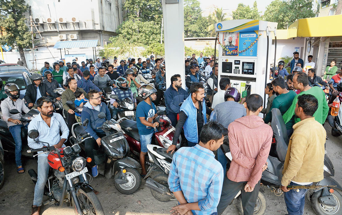People queue up at a petrol pump in Guwahati on Saturday