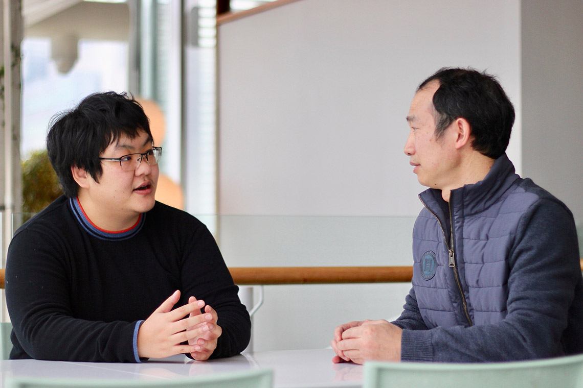 Jing Hou (left) and Guihong Tan are uncovering how minute discrepancies between genomes translate to individual differences within a species
