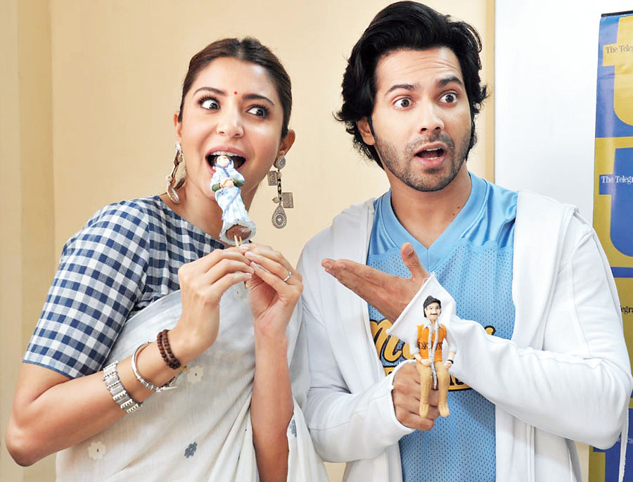 """Nom Nom: """"What's she doing?!"""" mock-screamed Varun as Anushka took a bite of 'Mamta'!"""