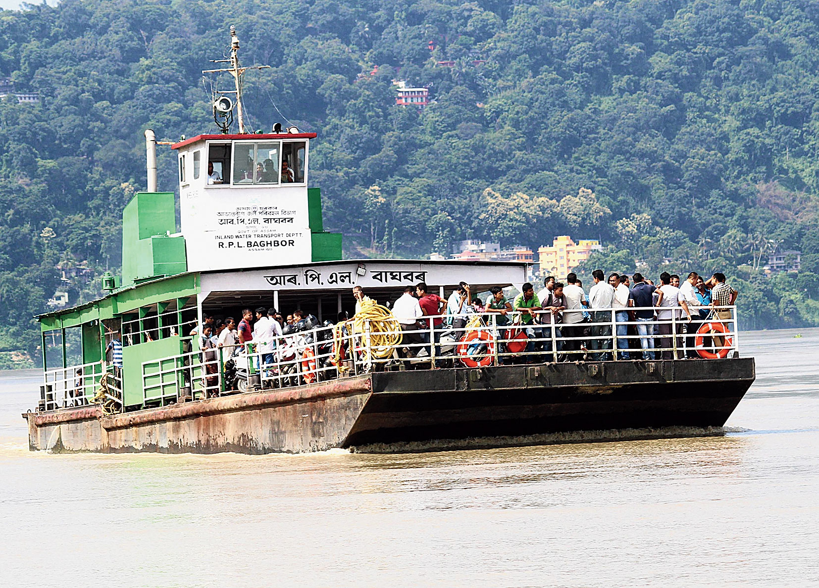 A ferry filled with passengers on the Brahmaputra.