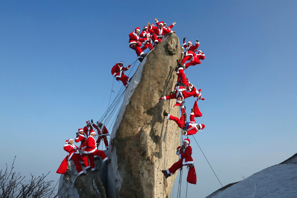 Mountain climbers in Santa Claus outfits during an event in Seoul, South Korea, on December 22