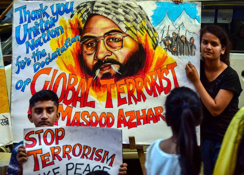 Students cheer the blacklisting of Jaish-e-Mohammad head Masood Azhar by the UN Security Council, in Mumbai on Thursday, May 2, 2019