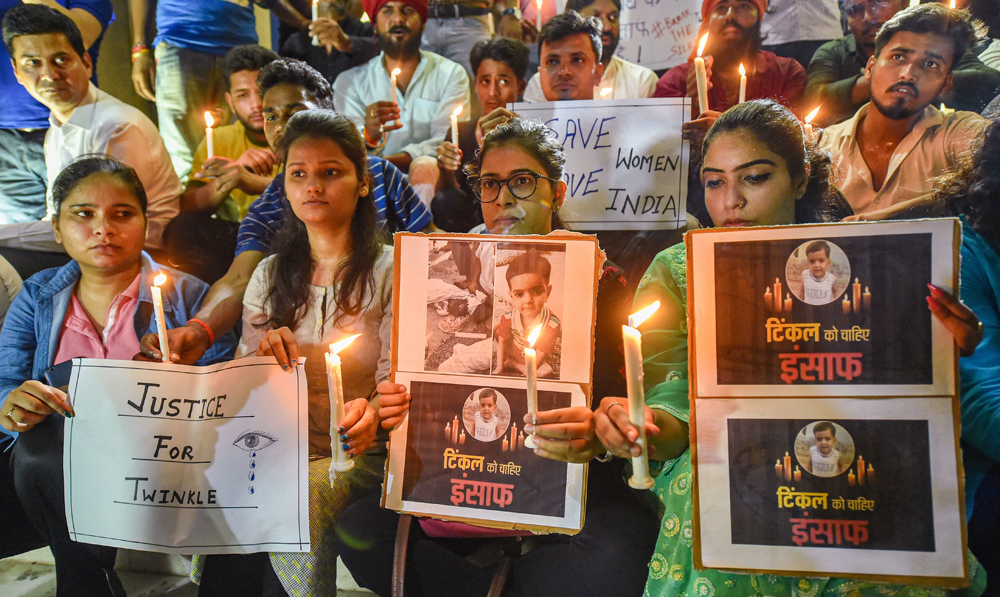 Lucknow University students participate in a candle-march against killing of a girl in Aligarh, in Lucknow, Friday June 7, 2019.