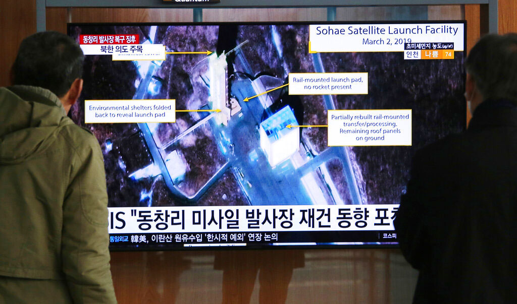 In this March 6, 2019, file photo, people watch an image of the Sohae Satellite Launching Station in Tongchang-ri, North Korea, during a news programme at the Seoul Railway Station in Seoul, South Korea.