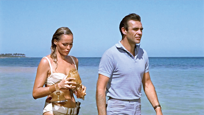 Sean Connery and Ursula Andress on location in Jamaica during filming Dr No. (Right) Live And Let Die, one of the five books to be auctioned on Wednesday