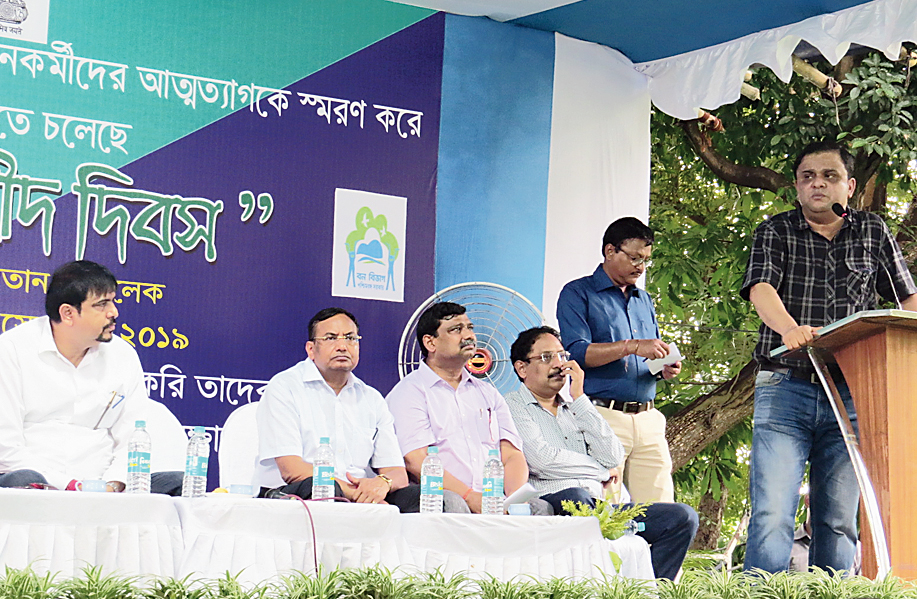 Forest minister Bratya Basu addresses the gathering. Fire and emergency services minister Sujit Bose is to the extreme left