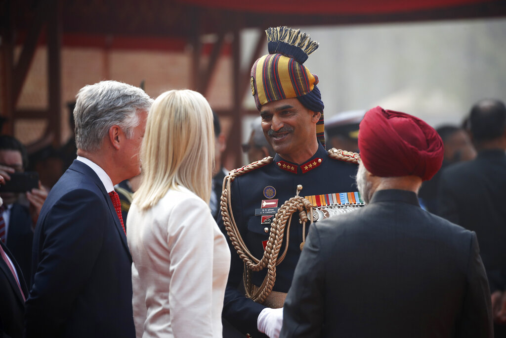Ivanka Trump, the daughter and senior adviser to U.S. President Donald Trump, speaks with an Indian officer as they wait for a ceremonial welcome for US President Donald Trump at Rashtrapati Bhavan, the presidential palace, in New Delhi