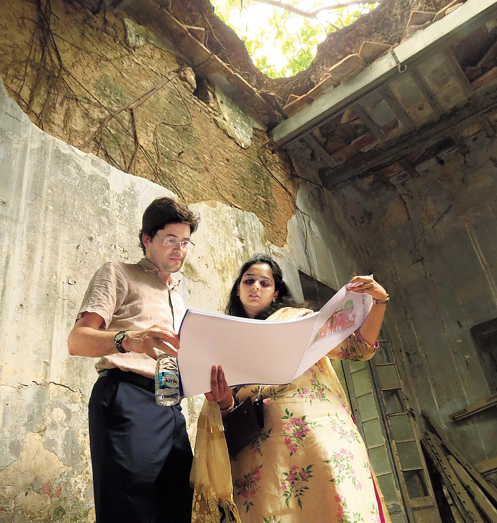 Conservation architects Raphael Gastebois and Aishwarya Tipnis study a restoration plan.