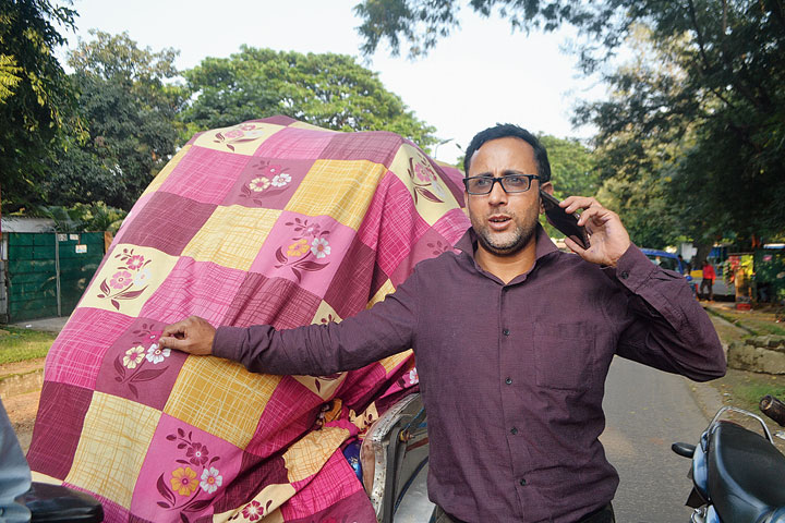 Zahoor Payer talks to his kin at Kupwara in Kashmir from Bistupur, Jamshedpur, on Monday.