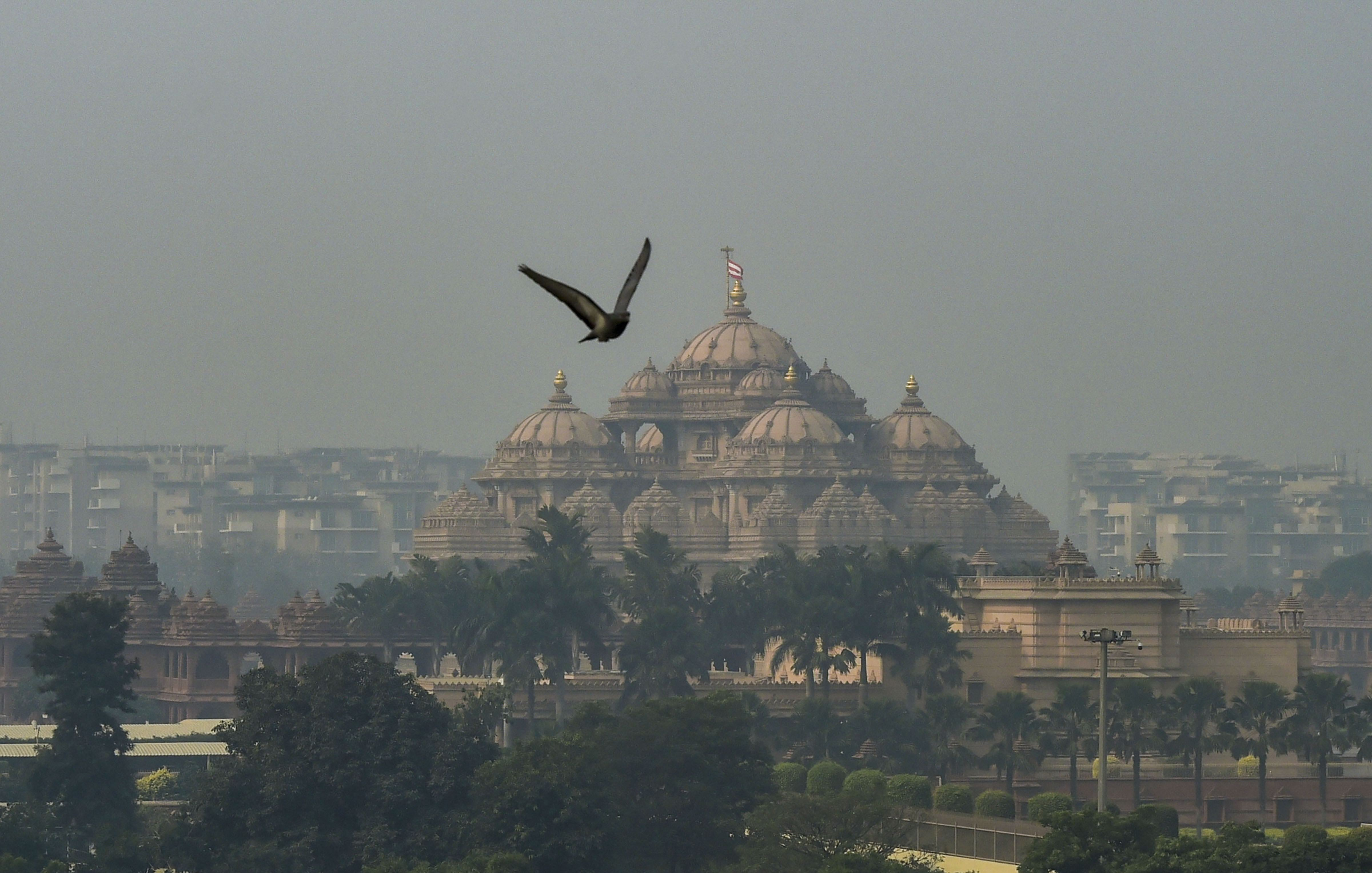A view of Akshardham temple shrouded in haze post-Diwali celebrations, in New Delhi, Monday, October 28, 2019.