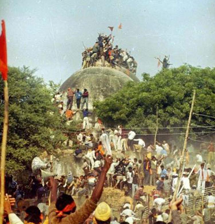 Kar Sevaks atop the Babri masjid shortly before it was demolished
