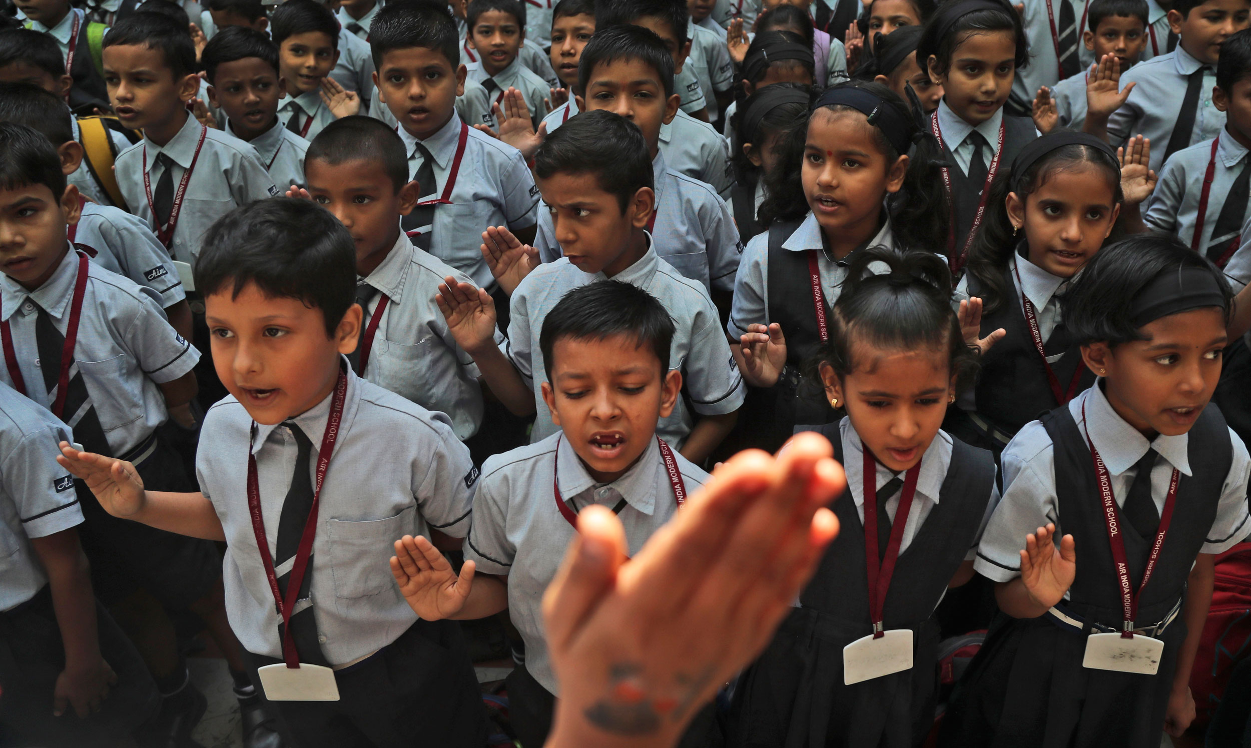 Students recite the Preamble to the Indian Constitution during their school assembly in Mumbai on Monday.