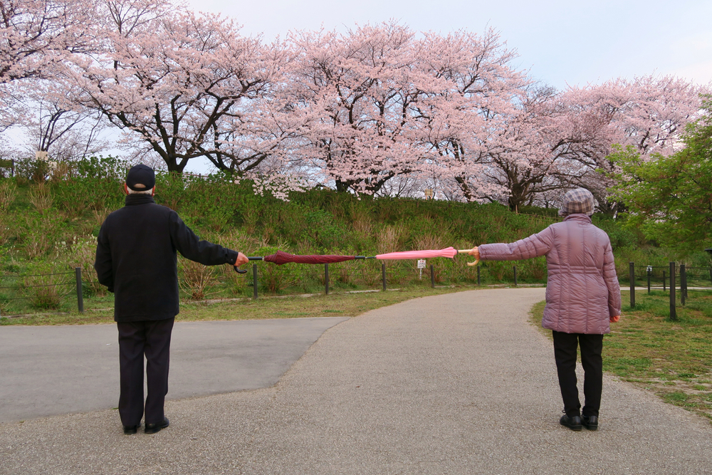 A woman and her partner stand apart holding two umbrellas. (Image used for representational purpose)