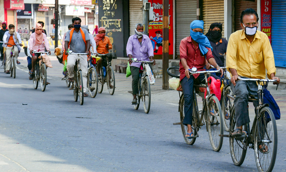 Some among 25 migrant workers who are cycling to their native place from Haryana amid Covid-19 lockdown, pass through Muzaffarnagar, Thursday, April 30, 2020.
