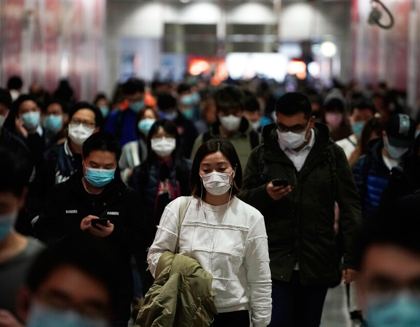 People wearing masks, walk in a subway station, in Hong Kong, Friday, February 7, 2020. Hong Kong on Friday confirmed 25 cases of a new virus that originated in the Chinese province of Hubei. According to the latest figures, 233 new cases of the novel coronavirus have been confirmed globally.