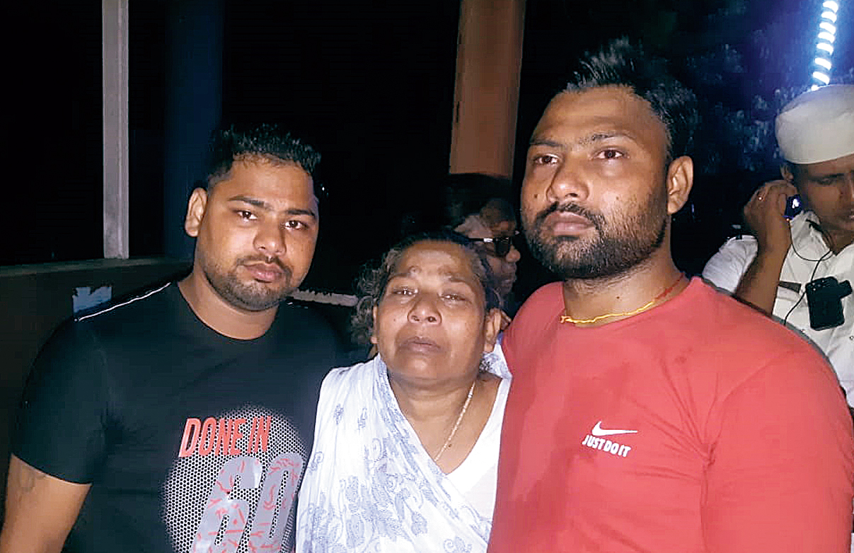 Malati Basfore with her sons Jibon and Vola