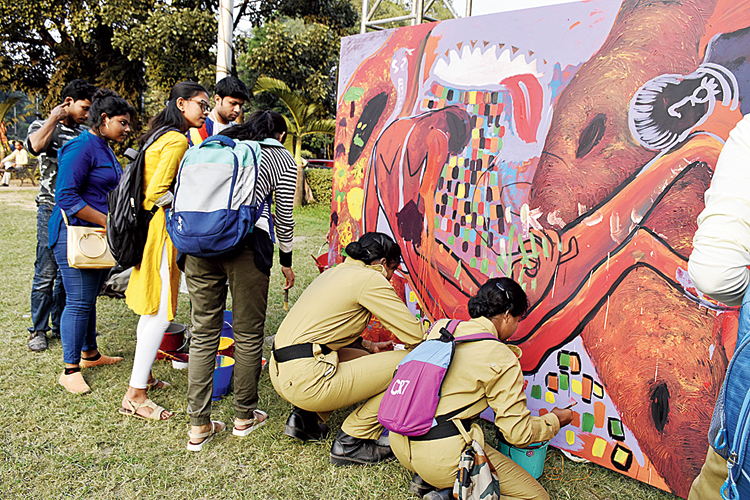 Two NCC cadets were seen picking up the paintbrush and adding their own touch to one of the canvases that some students from the Government College of Art & Crafts painted before them.