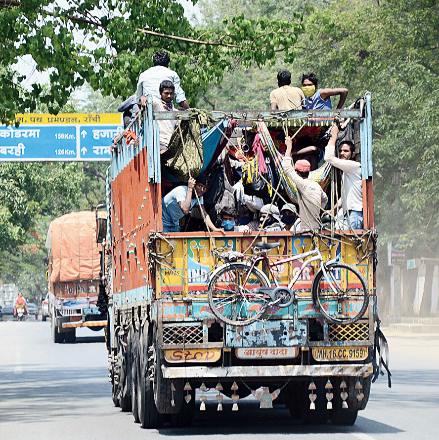 RISKY RIDE: Migrant labourers from Sahebganj, who were stranded in Odisha because of the lockdown, on their way home on a truck via HB Road in Ranchi on Monday.