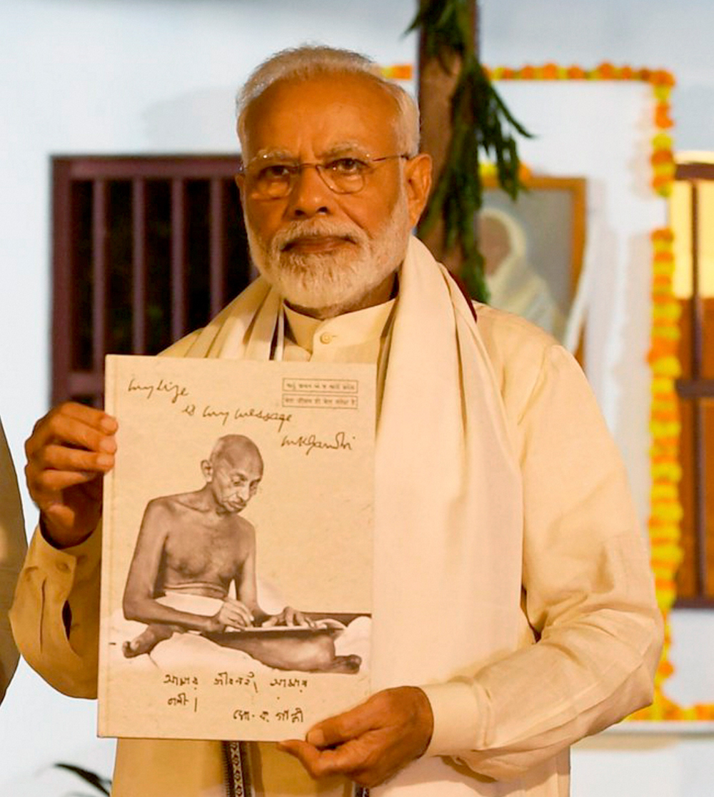 Prime Minister Narendra Modi visits Sabarmati Ashram on the occasion of Mahatma Gandhi's 150th birth anniversary in Ahmedabad on Wednesday