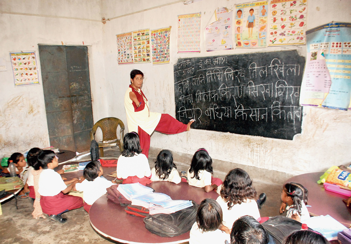 Basanti Kumari writes on a blackboard with her toes at her school in Dhanbad on Tuesday