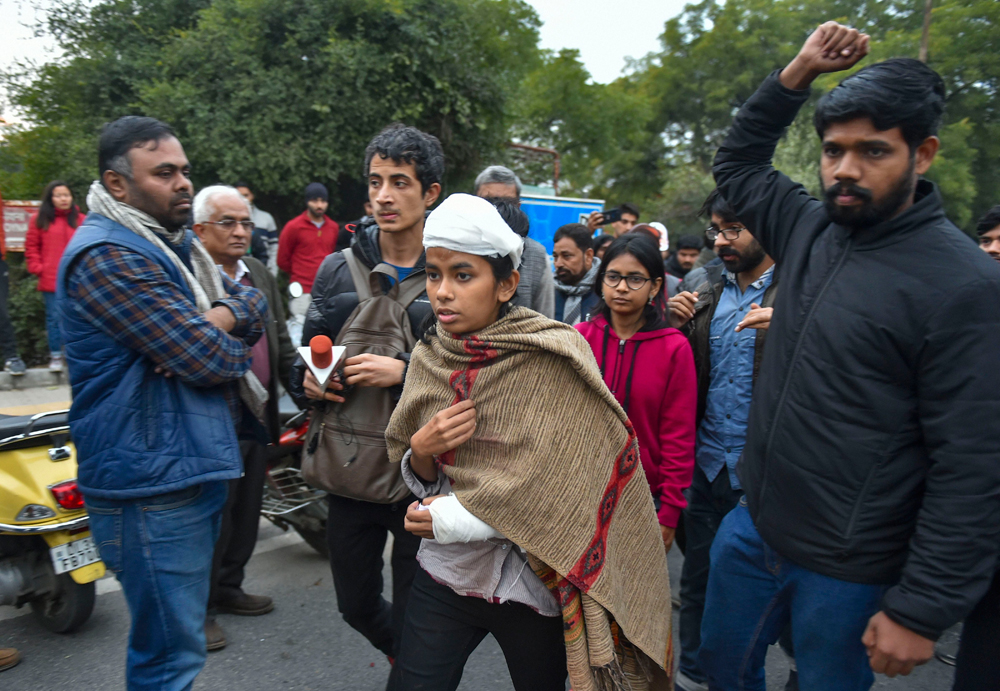 Aishe Ghosh leaves after speaking at a news conference in New Delhi on Monday