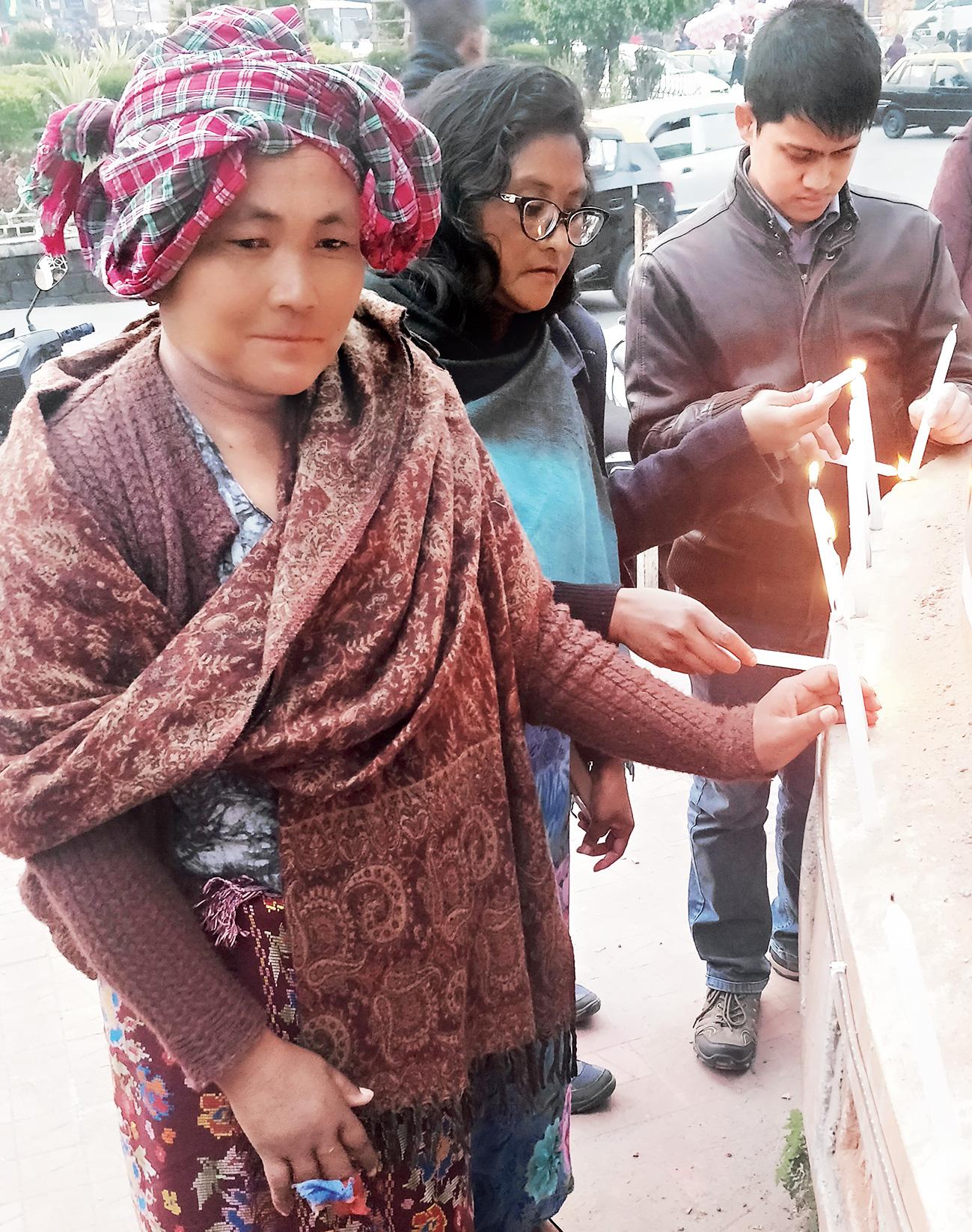 Amita Sangma lights a candle.
