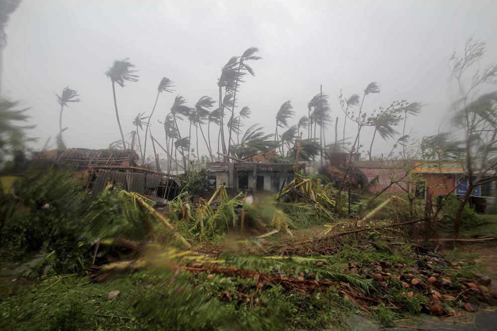 Damaged structures and uprooted tress lie along a road in Puri after Cyclone Fani hit the coastal state of Odisha on Friday, May 3, 2019