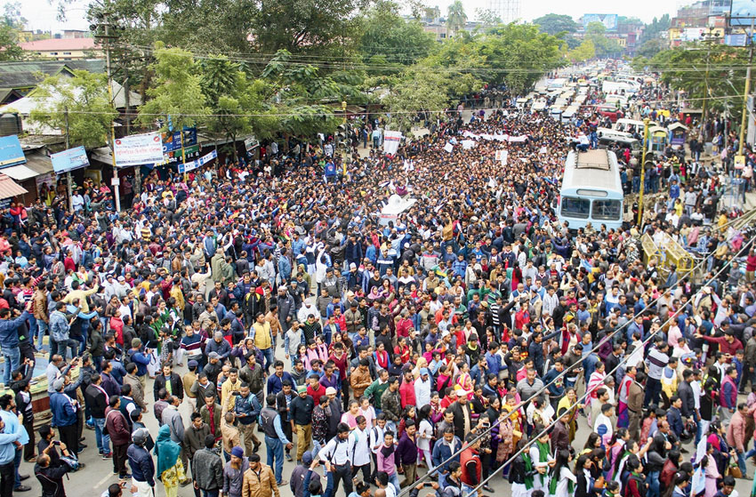 Protesters gather on the outskirts of Sivasagar town.