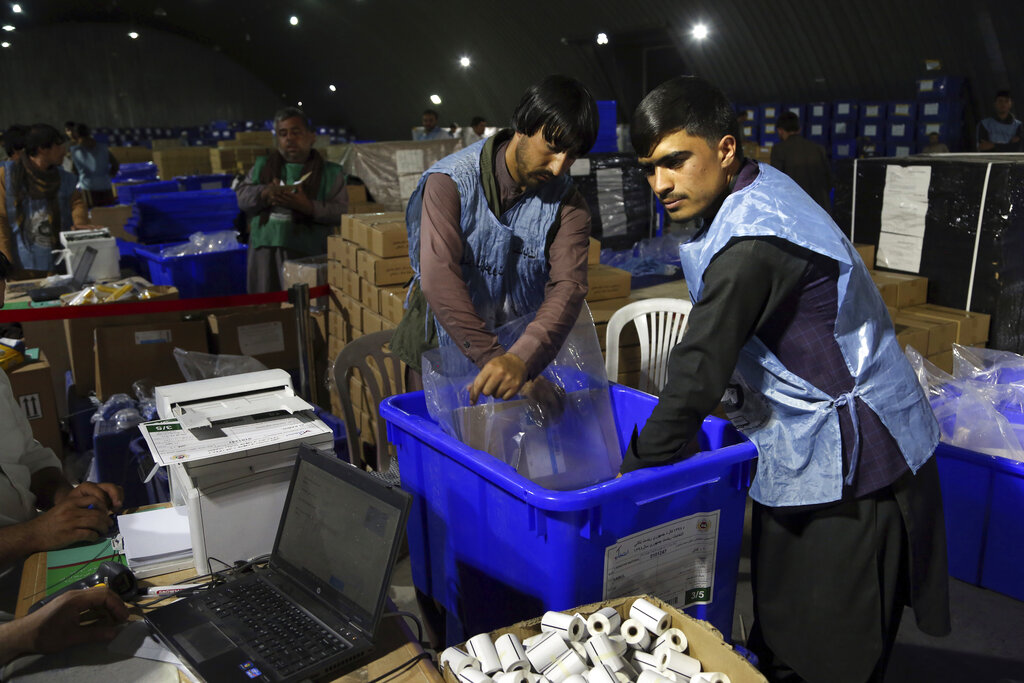 Election commission workers prepare ballot boxes and election materials for the presidential election scheduled for September 28, at the Independent Election Commission compound in Kabul, Afghanistan, Sunday, September 15, 2019