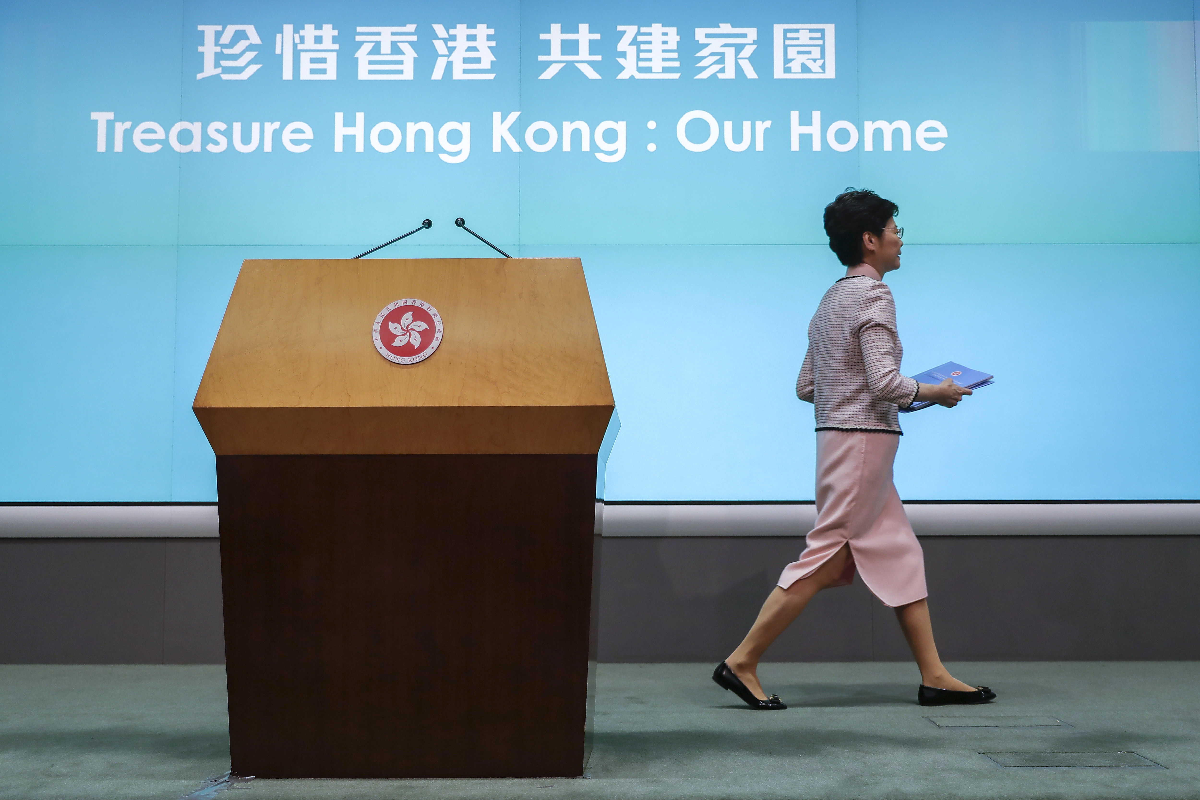 Hong Kong Chief Executive Carrie Lam leaves the stage after a press conference at the Legislative Council in Hong Kong  on Wednesday, October 16, 2019