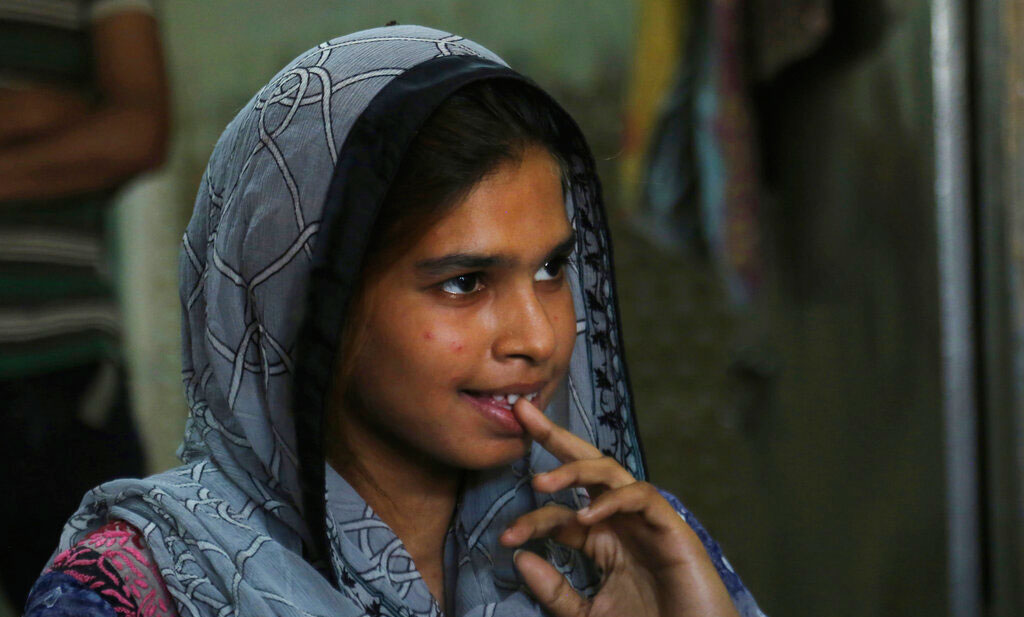 In this April 14, 2019 photo, Muqadas Ashraf in Gujranwala, Pakistan. Muqadas Ashraf was just 16 when her parents married her off to a Chinese man who had come to Pakistan looking for a bride.
