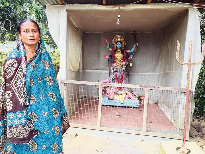 Sahanara Begum in front of the Kali temple at Durgapur village in Sepahijala district in Tripura